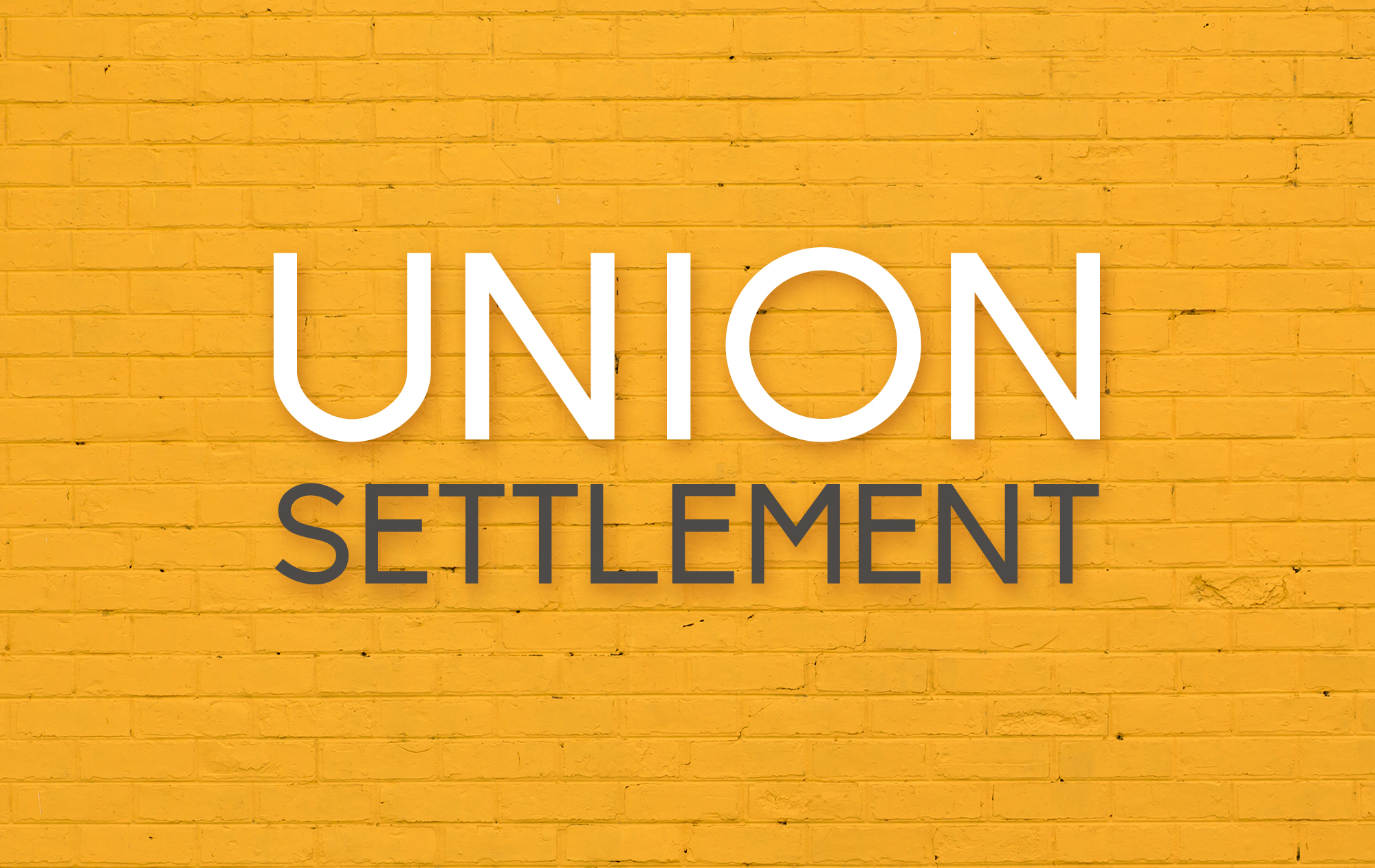 Union Settlement logo against brick background