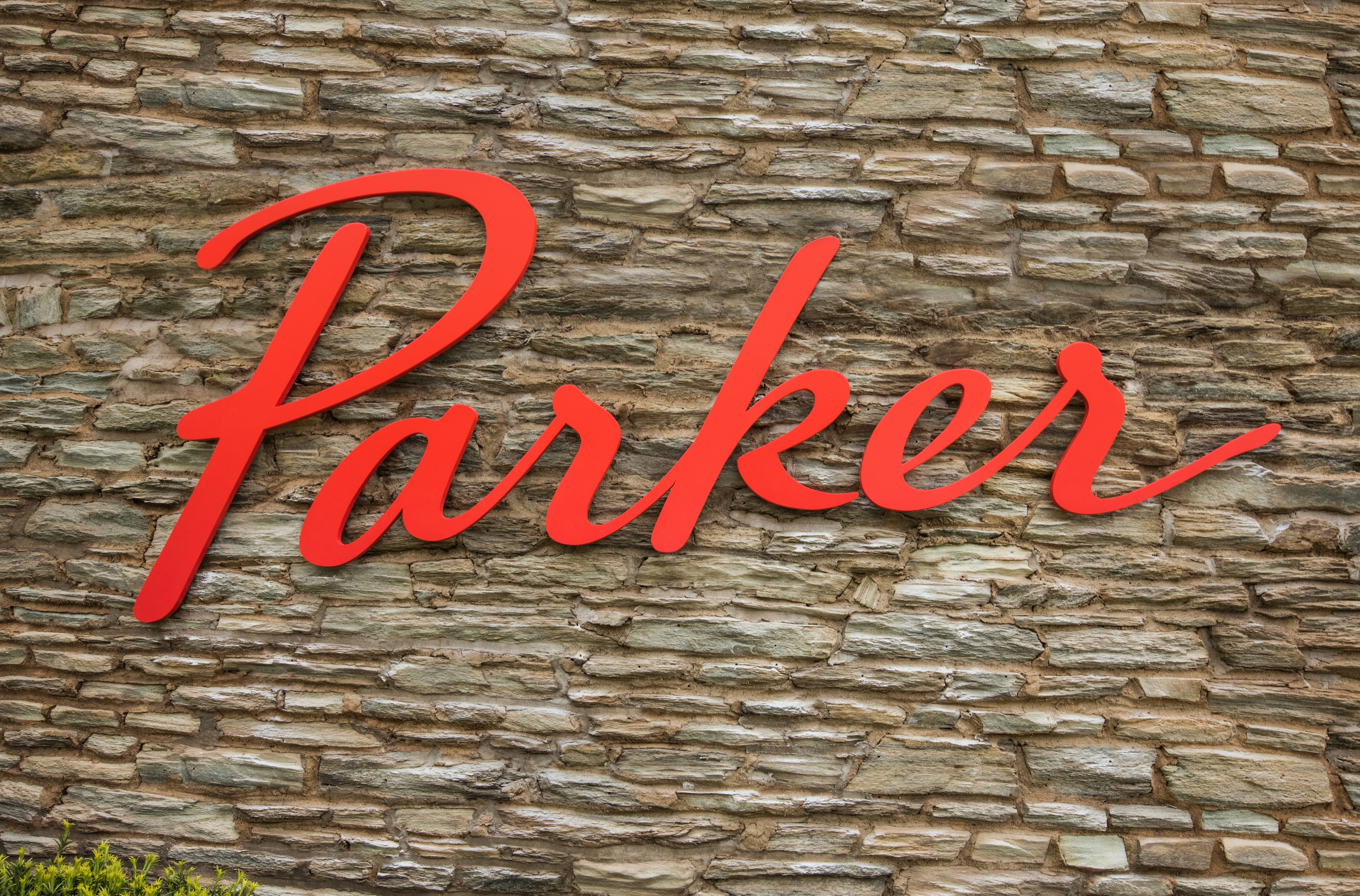 Parker's hand drawn logo on stone wall